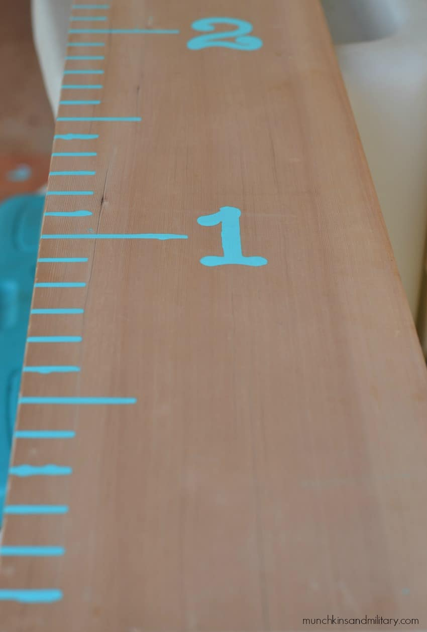 Make a beautiful growth chart for your family using just a board, stencils, and some paint!