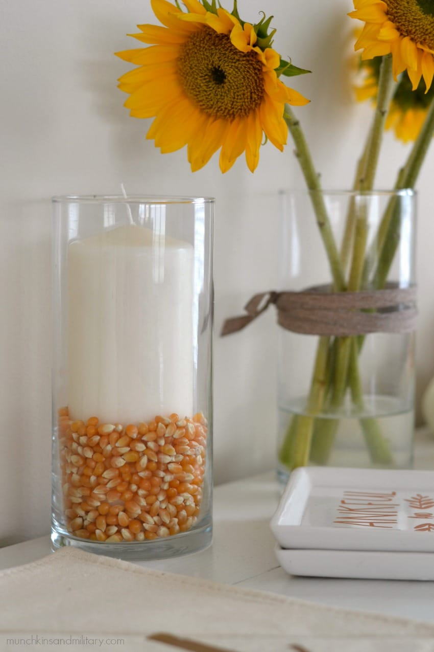 Fall home decor - a candle and corn in a dollar tree vase