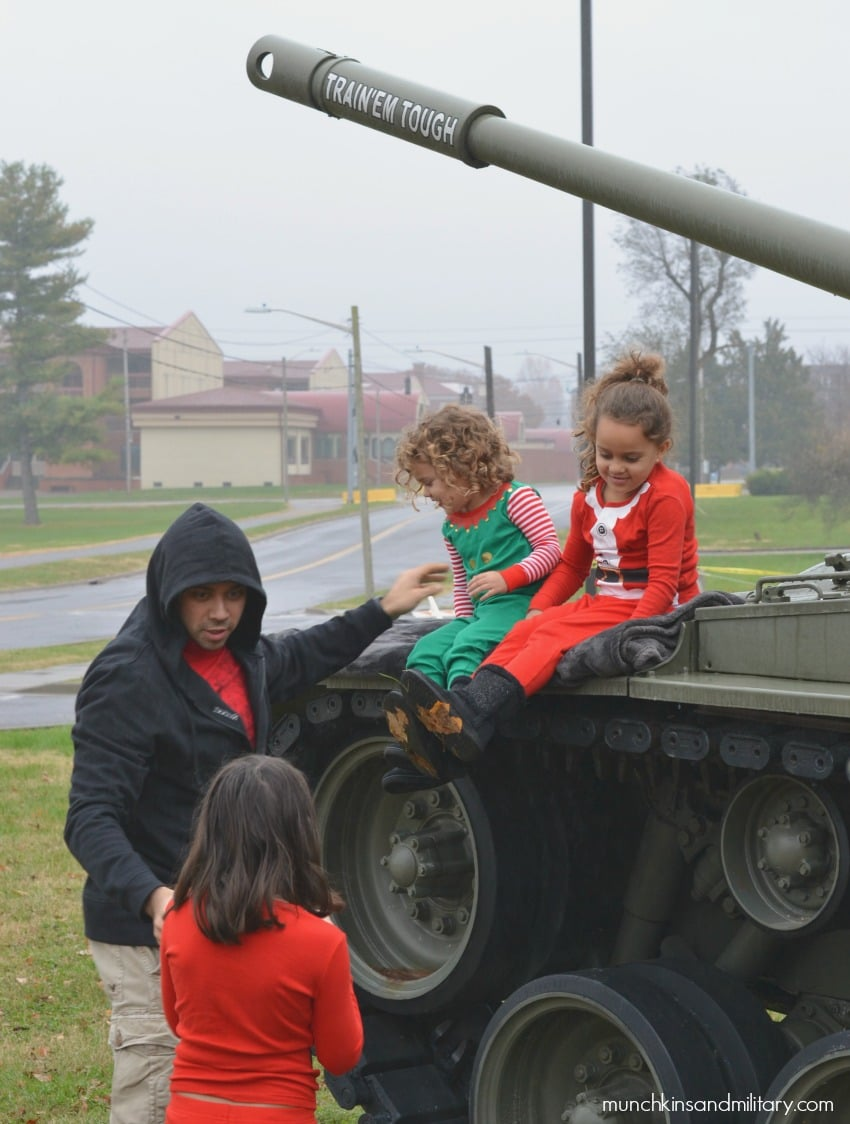 Army kids on a tank for Christmas photos