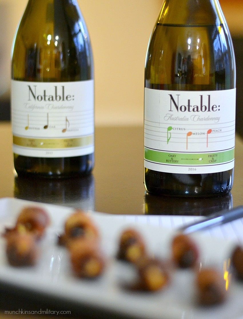 Two Notable wine bottles with bacon-wrapped goat cheese stuffed dates