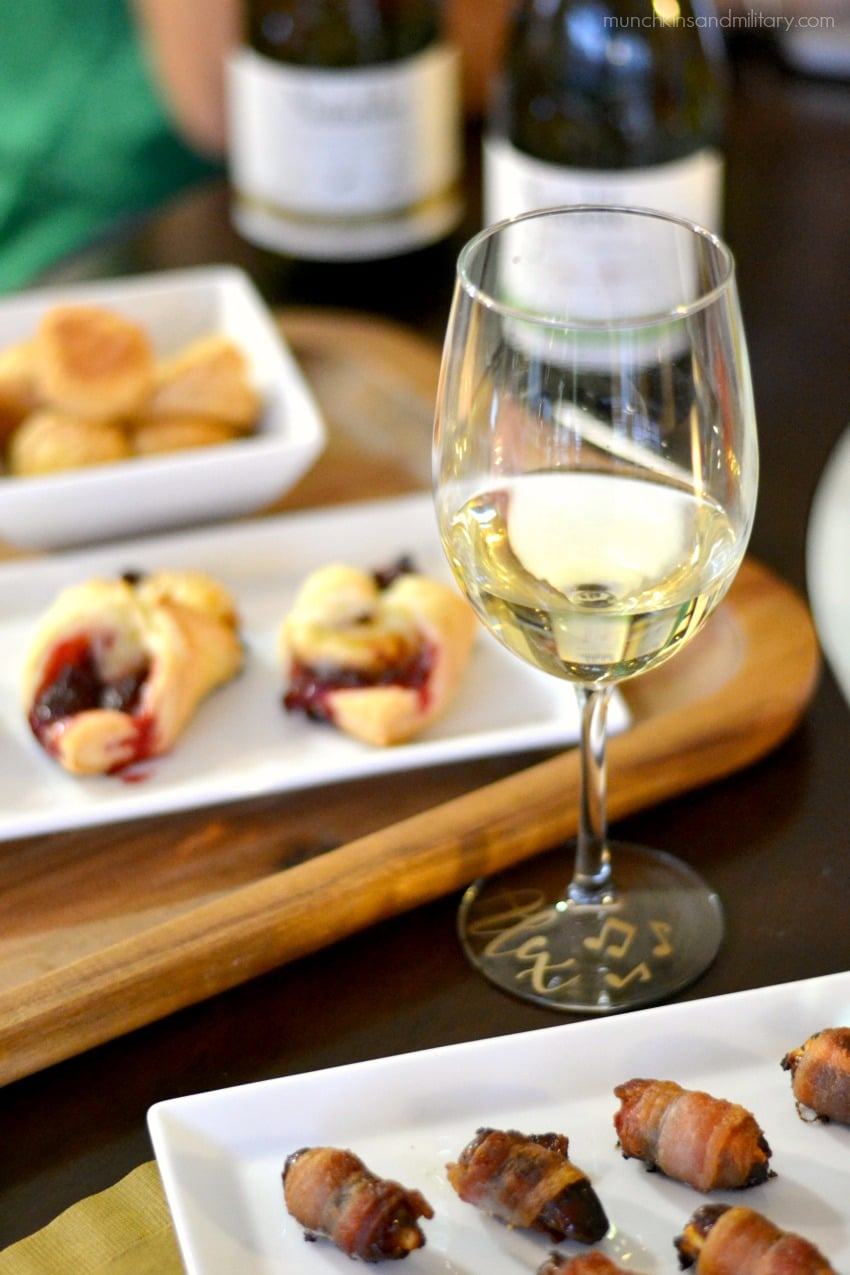 All the makings for a perfect wine night! Chardonnay wine paired with bacon wrapped goat cheese dates, cranberry tartlets, and puff pastry