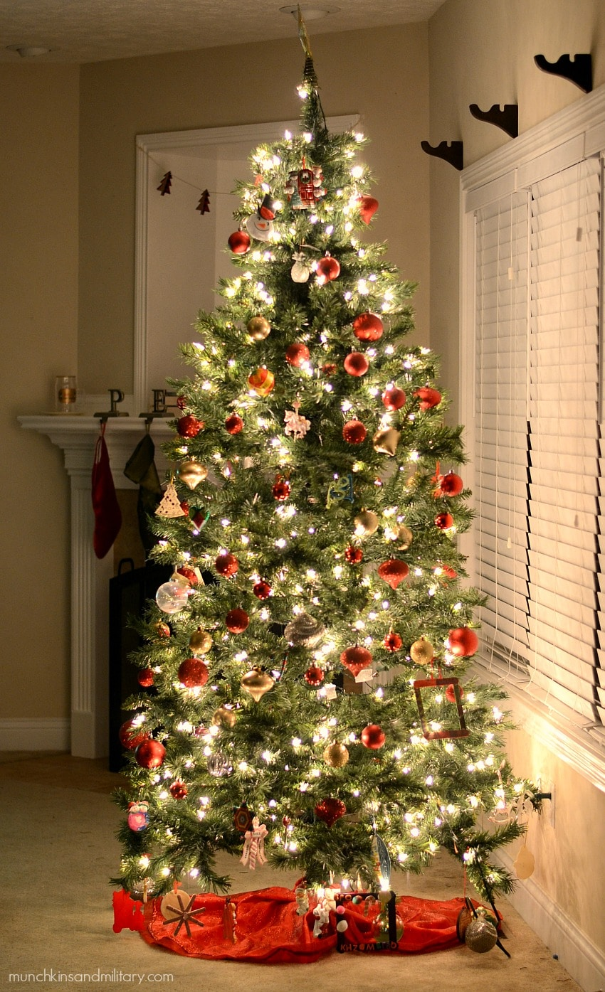 Glowing decorated Christmas tree with red ornaments