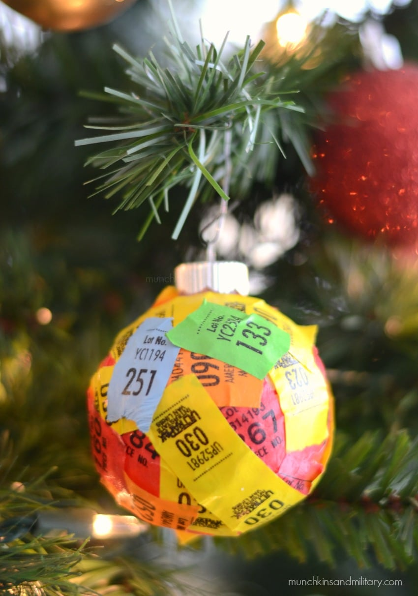 Military spouse Christmas tree ornament with moving stickers from past PCSs