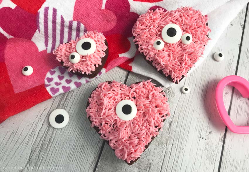 Brownies with pink frosting and candy eyes, designed to look like monsters