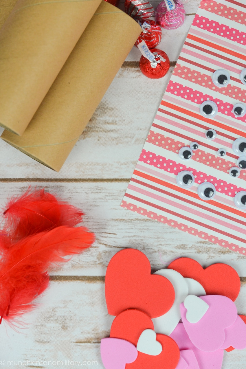 Valentine's Day treat craft supplies! Cardboard rolls, googly eyes, feathers, and foam hearts