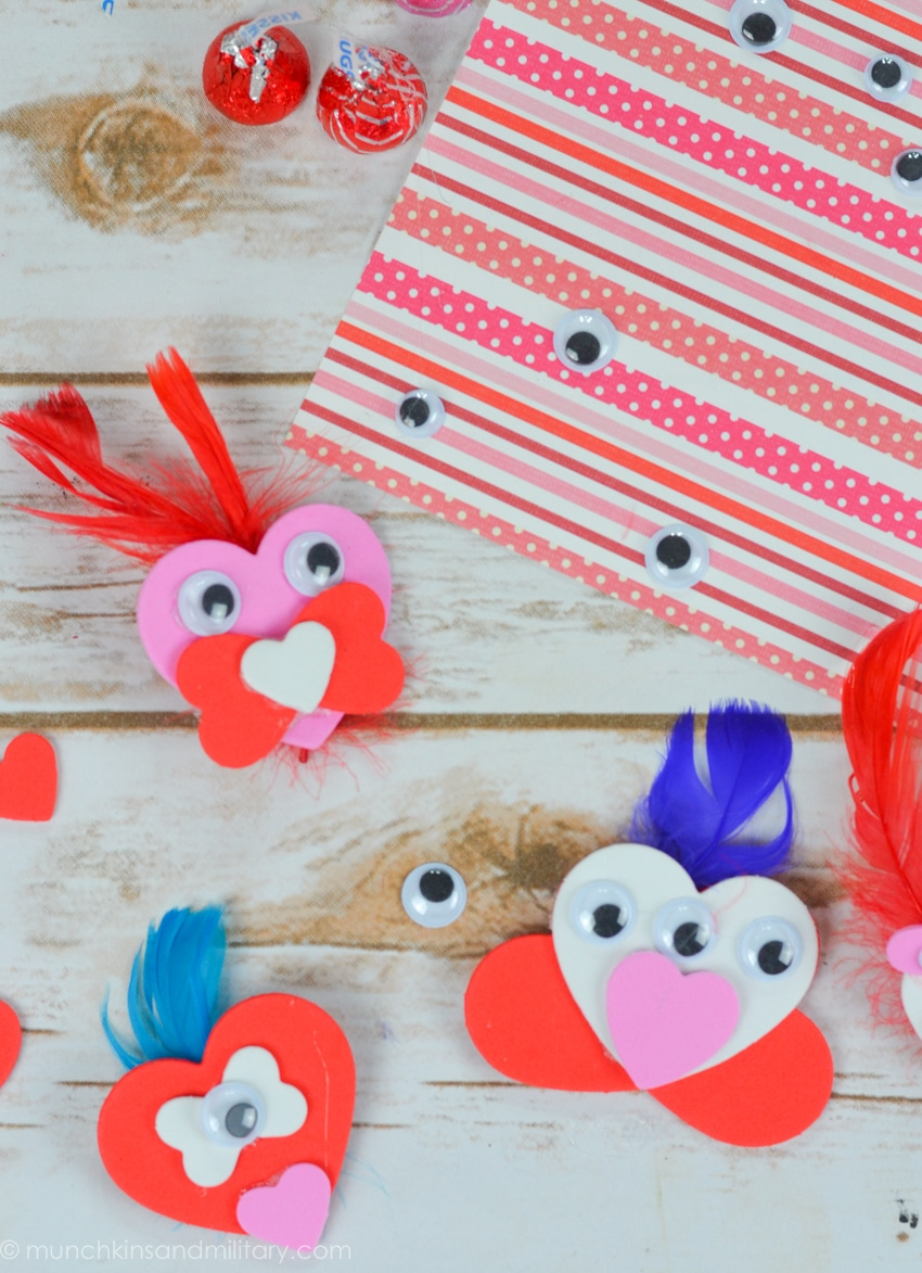 DIY Valentine's Day treat craft supplies - red, pink, white foam hearts with googly eyes and feathers