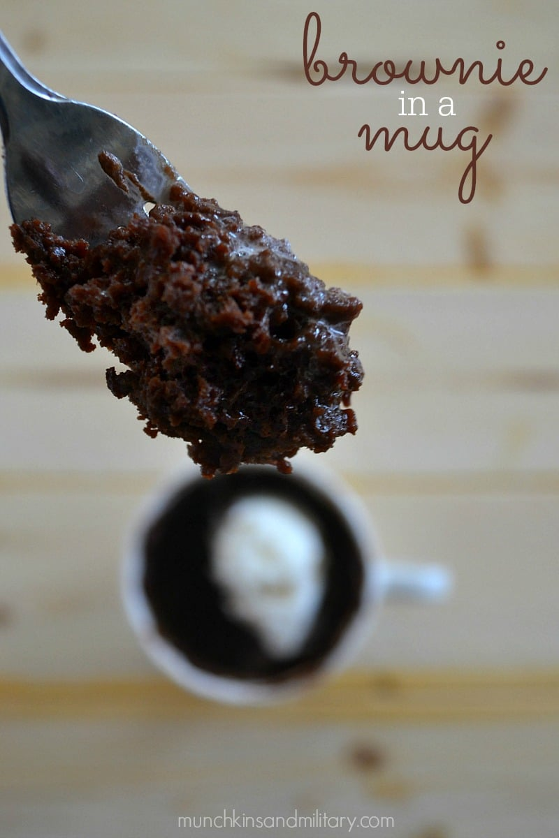 close up of a fork with a bite of brownie mug cake on it